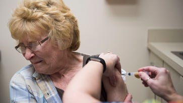 Flu fills hospitals 'everywhere' in state as season peaks early; vaccine poor match for most common strain