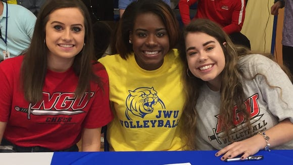 Eastside recognized 21 seniors during its signing ceremony Thursday, including, from left, Makenna Driggers (cheer, North Greenville), Demya Scott (volleyball, Johnson & Wales, R.I.) and Katherine McClure (volleyball, North Greenville).