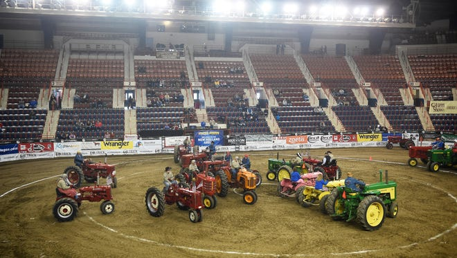 Two groups, Tractor Buddies, of Somerset County, and Middlecreek Tractor Swinger, of Snyder County, performed at the 2016 Pennsylvania Farm Show on Friday,  Jan. 15. The choreographed performance features tractors running complicated maneuvers to good ole' fashioned square dance music.