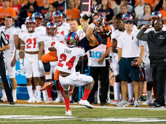 Illinois wide receiver Mike Dudek (18) cannot hold onto a pass as Western Kentucky defensive back Roger Cray (24) defends during the first quarter of a game Sept. 9 in Champaign, Illinois.