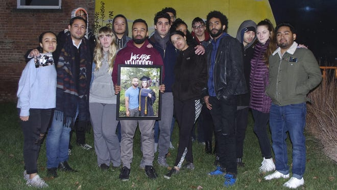 A group of Rebekah Grohl's friends gathered Monday night to remember the young Newburgh activist, who died Sunday. The photo of Grohl was from her 2018 graduation from SUNY Orange. Her boyfriend, Steven Majano, is at her side.