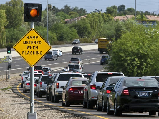 Rush-hour motorists wait for the light on the west-bound on-ramp to I-10 from Elliot Road in Tempe, Ariz.