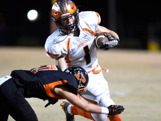 Greenback's Kayne Roberts tries to avoid a tackle by South Pittsburg's Ronto Tipton  on  in a Class 1A semifinal game at South Pittsburg.
