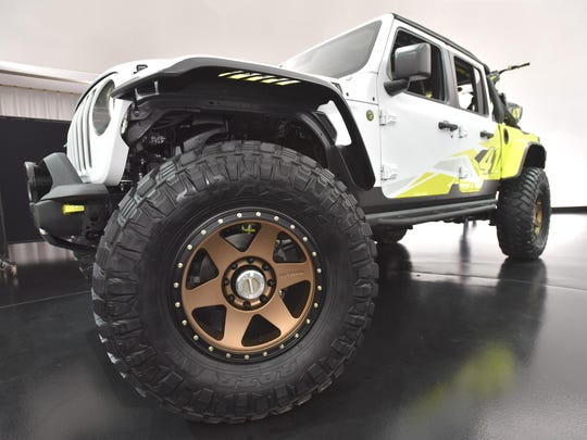 This is a front wheel on the Jeep Flatbill, colored in white and acid green.