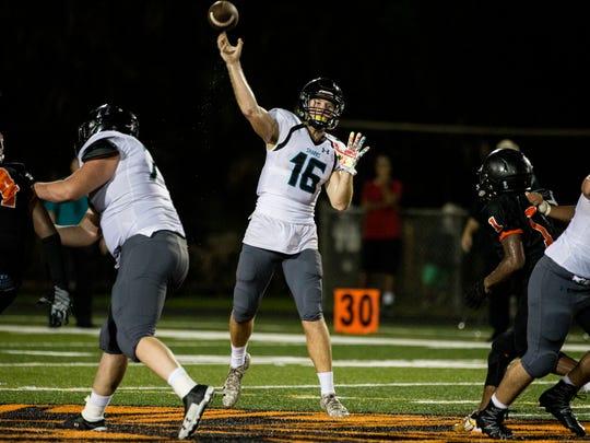 Gulf Coast High School quarterback Kaden Frost throws