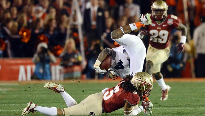 Jan 6, 2014; Pasadena, CA, USA; Auburn Tigers wide receiver Quan Bray (4) is tackled by Florida State Seminoles defensive back Ronald Darby (3) during the second half of the 2014 BCS National Championship game at the Rose Bowl.  Mandatory Credit: Jayne Kamin-Oncea-USA TODAY Sports