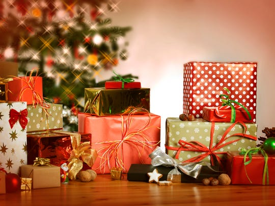 many Christmas presents on a table in the background a Christmas tree