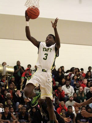 Frank Royles of Taft flies high on his way to the net. He led all scorers with 28 points.