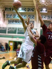 Farmington's Tyren King shoots during Tuesday's game against Shiprock at Scorpion Gym.