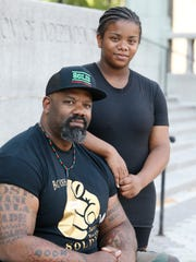 Mahkieb Booker and his daughter, Imani, 15. She is considering a career in law enforcement.