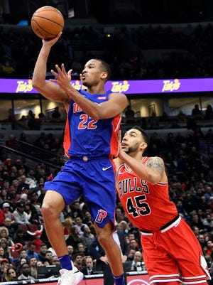 Pistons guard Avery Bradley (22) shoots the ball as Bulls forward Denzel Valentine (45) defends him during the first half on Saturday, Jan. 13, 2018, in Chicago.