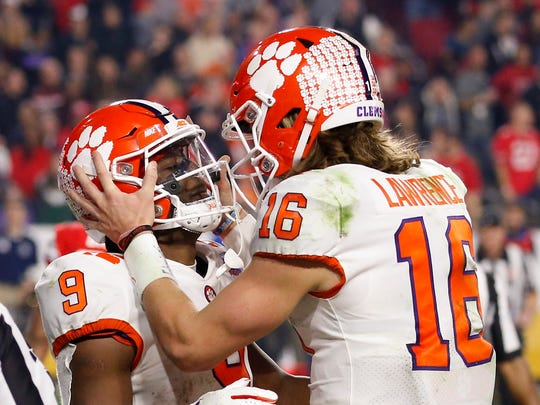 Clemson running back Travis Etienne, celebrates his touchdown with quarterback Trevor Lawrence during the second half of the team's Fiesta Bowl NCAA college football playoff semifinal against Ohio State on Saturday, Dec. 28, 2019, in Glendale, Ariz. (AP Photo/Ross D. Franklin)
