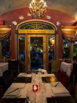 Café Matisse seduces with its colorful walls, whimsical chandeliers and starched tablecloths.