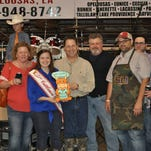 """Members of Team Billy accept first and second place trophies in the roast division during Sunday's """"Here's the Beef"""" cook-off. They were one of dozens of teams that entered 51 dishes in this year's contest hosted by the St. Landry Parish Cattleman's Association, the cattlewomen's association and the Louisiana Beef Industry Council."""