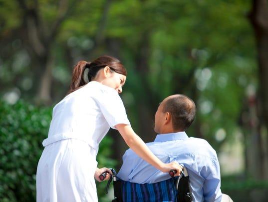 635992608868096854-NurseWheelchair.jpg