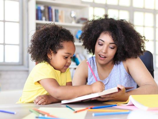 Teacher learning little girl
