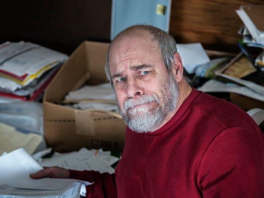 Senior Adult Man Hoarder In Messy Office Room
