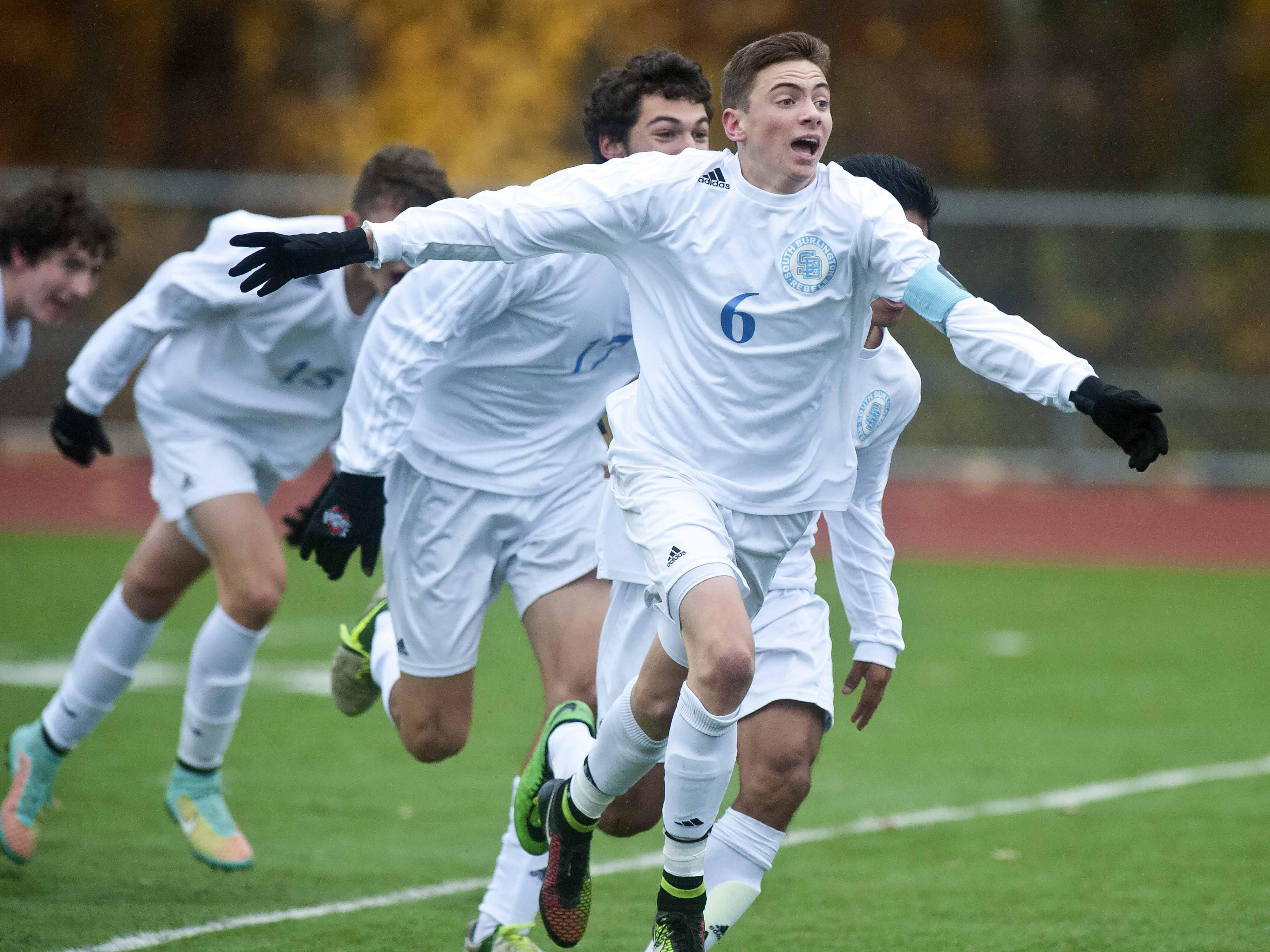 South Burlington's Alex Pasanen celebrates after scoring the equalizer with 8.4 seconds left in regulation against Essex in November's Division I final. The Rebels won in penalty kicks.