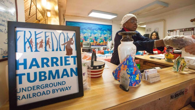 Owner Bonnie White works Tuesday at Ms. Bonnie's Savor the Flavors Seafood Restaurant in the Wilmington neighborhood of Southbridge. The restaurant is one of the first official Harriet Tubman Underground Railroad Byway-affiliated businesses