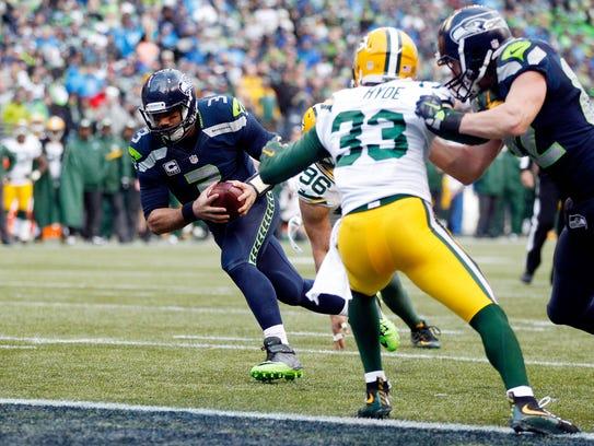 Seattle Seahawks quarterback Russell Wilson runs for