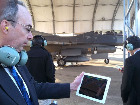 2012: From left, Winooski Mayor Mike O'Brien checks decibel level on an F-16 preparing for takeoff along with Gov. Peter Shumlin and Burlington Mayor Miro Weinberger during a demonstration at Eglin Air Force Base in Florida. The meter showed levels similar to the F-35.