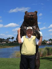 Jack Nicklaus poses with the bear on the 15th tee in 2010. David Cannon/Getty Images
