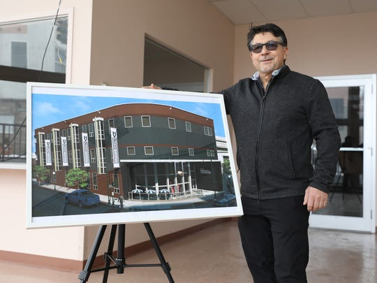 Louie Lanza, with the Hudson Hospitality Group, is pictured in the lobby of the old worker's compensation building on North Division street in Peekskill, Feb. 8, 2018. He has plans to create a MoCA art gallery and a boutique hotel for the property.