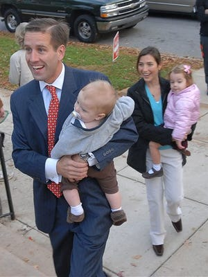 FILE - In this Tuesday, Nov. 7, 2006 file photo, Delaware Attorney General candidate Beau Biden, holds his son, Hunter, as he walks with his wife, Hallie, holding their daughter, Natalie, as they enter a polling place to cast their votes in Wilmington, Del. On Saturday, May 30, 2015, Vice President Joe Biden announced the death of son, Beau, from brain cancer. (AP Photo/Pat Crowe II)