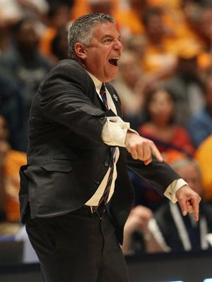 Auburn head coach Bruce Pearl directs his team against Tennessee during the second half of an NCAA college basketball game in the Southeastern Conference tournament in Nashville, Tenn., Wednesday, March 9, 2016.