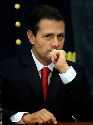 Mexico's President Enrique Pena Nieto pauses during a press conference at Los Pinos presidential residence in Mexico City, Monday, Jan. 23, 2017. Pena Nieto said Monday that Mexico's attitude towards the Donald Trump administration should not be aggressive or biased, but one of dialogue.