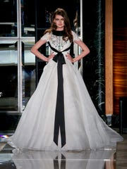 In this April 18, 2017 photo, bridal fashion from the Reem Acra collection is modeled in New York.