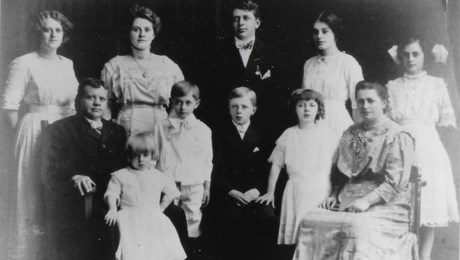 A portrait of Joseph Geisler Sr. and his wife Amelia Wirth Geisler and their children taken in 1910. Six members of the Rochester family were killed when their car was hit by a train on September 9, 1917, near Rush.