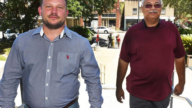Derrick Comeaux, left, and Paul Genusso arrive at the St. Landry Parish Courthouse Tuesday for the purpose of filing for a recall petition against Opelousas Mayor Reggie Tatum.