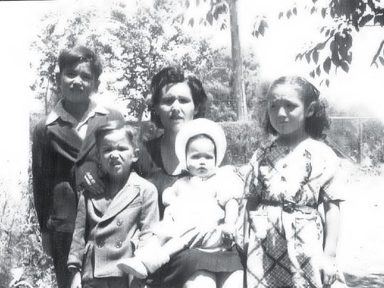 Cecilia Triviz Fitch Oliver gathers with her first four children, from left, Gilbert, David, Sylvia and Elizabeth in this 1945 photo, prior to the birth of her fifth child, Irene, who would immortalize her mom's pithy sayings in a play.
