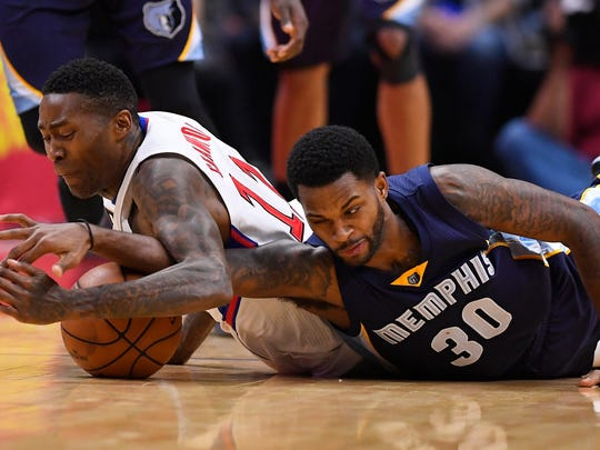 Los Angeles Clippers guard Jamal Crawford, left, dives