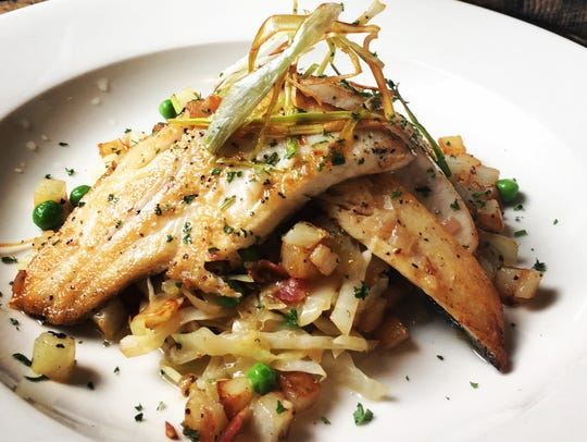 Chef Demitrie Phillips' pan-fried trout over cabbage