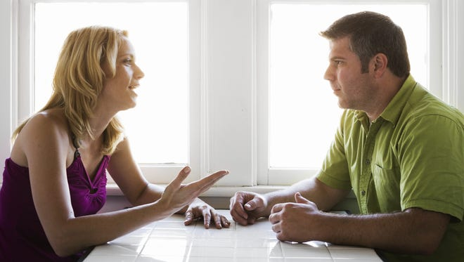 Stock photo of couple talking credit.