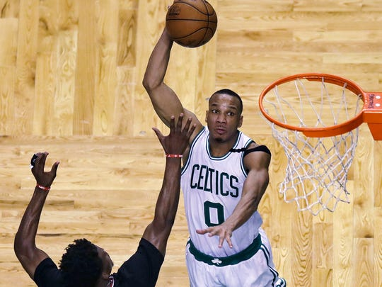 Celtics guard Avery Bradley lines up a dunk over the