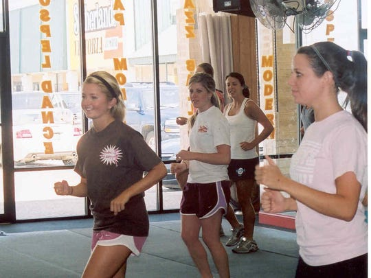 Caroline frierson leads an aerobics class at her debutante party.