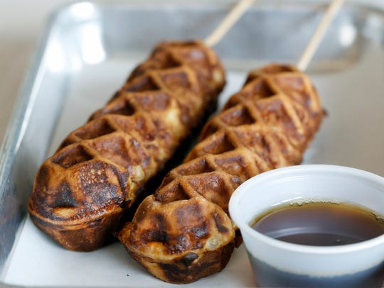 Waffles on a stick are served in pairs at Boxcar.