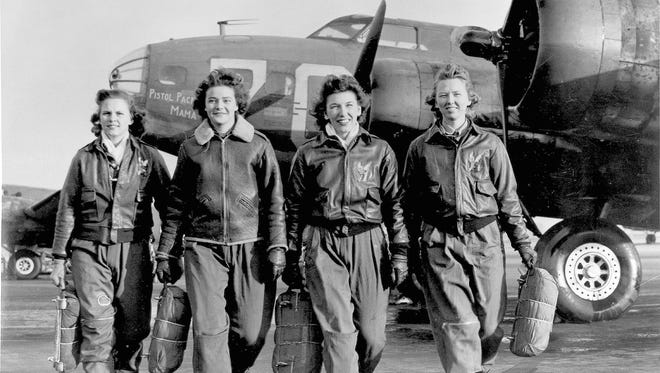 Four female pilots leaving their ship at the four engine school at Lockbourne are members of a group of WASPS who have been trained to ferry the B-17 Flying Fortresses during World War II