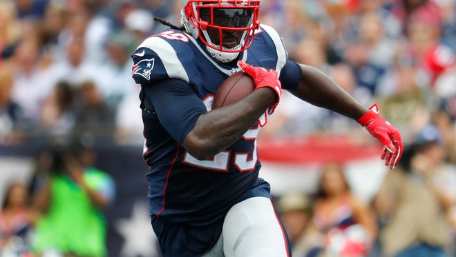 New England Patriots running back LeGarrette Blount runs against the Miami Dolphins during a NFL football game at Gillette Stadium in Foxborough, Mass. Sunday, Sept. 18, 2016.