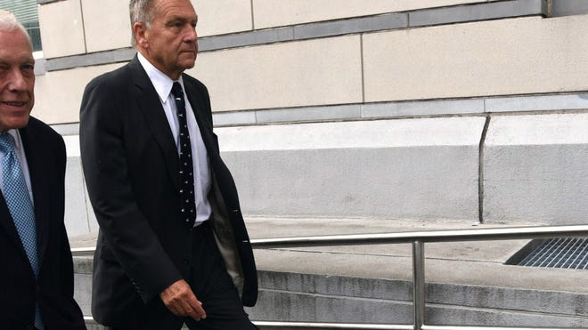 Former Port Authority Chairman David Samson on his way to federal court in Newark in July.