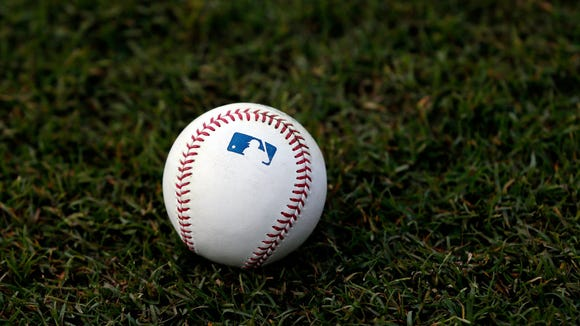 ATLANTA, GA - OCTOBER 03: A ball sits on the field prior to Game One of the National League Division Series between the Atlanta Braves and the Los Angeles Dodgers at Turner Field on October 3, 2013 in Atlanta, Georgia. (Photo by Kevin C. Cox/Getty Images) ORG XMIT: 183104054 ORIG FILE ID: 183007573 a01 1a editorial illustration studio baseball MLB logo grass