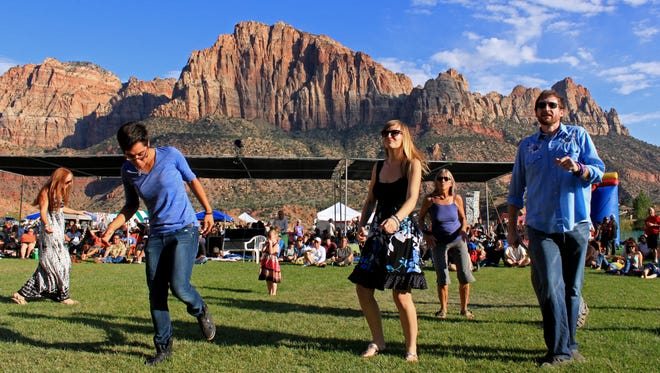 Visitors dance during the annual Zion Canyon Music Festival. A strong sense of community and the availability of outdoor activities were among the factors that residents in southwest Utah found most appealing about the area in a quality-of-life survey conducted this year by the Utah Foundation.
