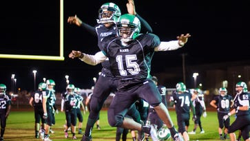 Parkside's Kemmon Walker (25) and Dajour Diggs (15) celebrate a win over Washington at County Stadium on Thursday evening.