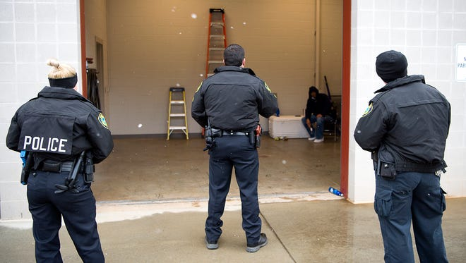 During a training exercise, Asheville Police officers talk to a man to practice de-escalating the situation Tuesday morning at the Woodfin training facility as part of an integrated training approach designed to help officers safely diffuse situations.