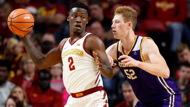 Iowa State forward Cameron Lard (2) drives around Western Illinois center Brandon Gilbeck (52) during Saturday's game in Ames.