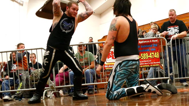 """J.J. DeVille slam a folding chair onto Izzy Lambert during an """"I Quit"""" round during an ASWA match at Malabar Middle School on April 9."""