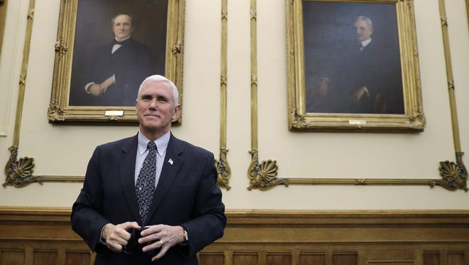 Vice President-elect Mike Pence is shown at the Indiana Statehouse after signing paperwork sending the state's electors to the Electoral College on Dec. 2.